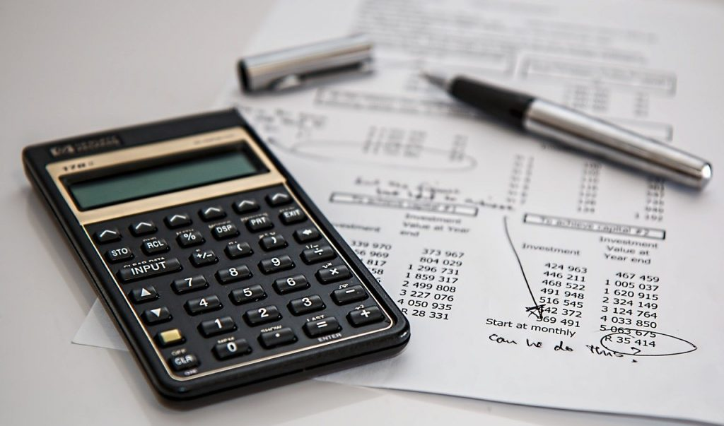 calculator and expense sheet for a beginner's guide to budgeting